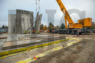 Crews with Todd Construction and NessCampbell Crane + Rigging tilt a concrete wall panel into place at Kellogg Middle School. (Josh Kulla/DJC)