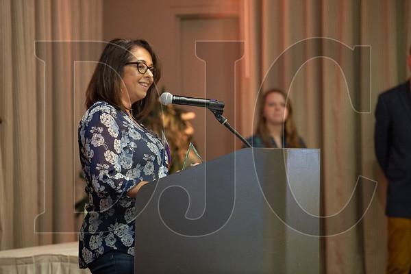 Michelle Brunetto accaps an award on behalf of Bremik Construction. (Sam Tenney/DJC)