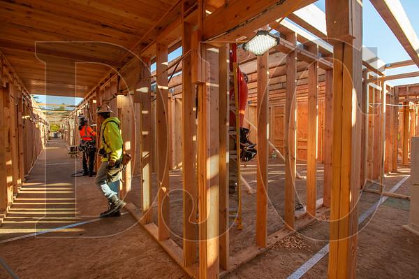 Wood Mechanix carpenters frame interior walls on the second floor of the Glisan Apartments. (Josh Kulla/DJC)