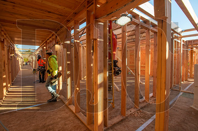 Wood Mechanix carpenters frame interior walls on the second floor of the Glisan Apartments. (Josh Kulla/DJC)