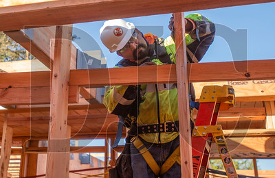 Juan Ledesma, a carpenter with Wood Mechanix, frames walls on the second level of the Glisan Apartments affordable housing project. (Josh Kulla/DJC)