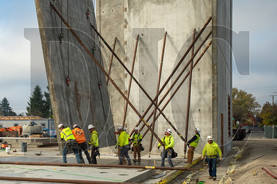 Crews with Todd Construction and NessCampbell Crane+ Rigging guide a concrete tilt panel wall into place at Kellogg Middle School in Southeast Portland.(Josh Kulla/DJC)