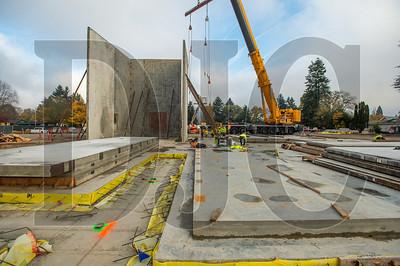 Crews prepare to rig a concrete tilt panel wall for the school's auditorium. (Josh Kulla/DJC)