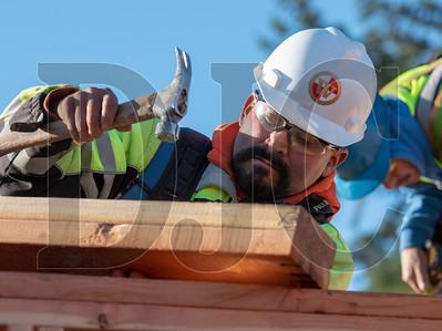 Wood Mechanix carpenter Juan Ledesma frames interior walls at the Glisan Apartments project. (Josh Kulla/DJC)