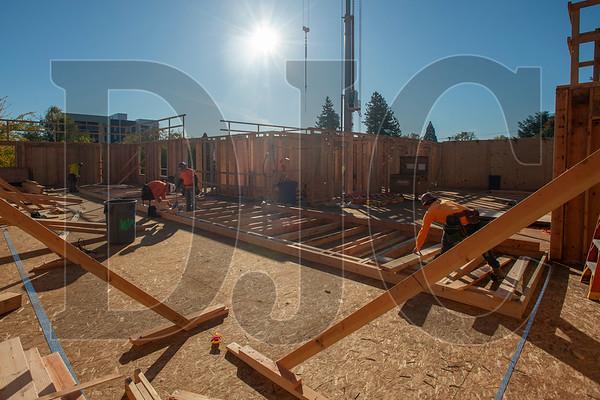 A crew of Wood Mechanix carpenters frames an interior wall at the Glisan Apartments project. (Josh Kulla/DJC)