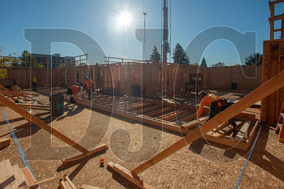 A crew of Wood Mechanix carpenters frames an interior wall at the Glisan Apartments project. (Josh Kulla/DJC)