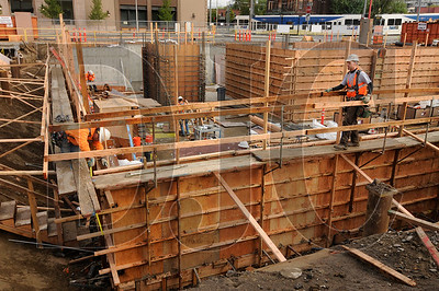 Workers construct concrete forms at the site of the Blanchet House of Hospitality project in downtown Portland on Wednesday.
