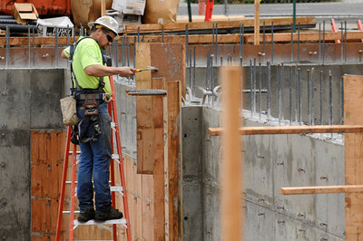 Journeyman laborer Mike Nyseth, an employee of Whitaker Ellis and member of Local 296, strips formwork from the foundation of the new Blanchet House building in downtown Portland on Wednesday.