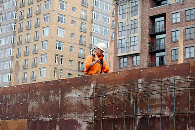 Apprentice carpenter Travis Jackson, an employee of Whitaker Ellis and member of Local 156, installs formwork at the site of the Blanchet House of Hospitality project in downtown Portland on Wednesday.  General contractor Fortis Construction is building a new four-story facility, which will include a first-floor kitchen and dining area and three floors of residential space.