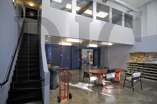 A former furniture warehouse in Southeast Portland was recently renovated by general contractor Mega Pacific Co. for National Marketshare Group, a company that helps manufacturers market their products to Kroger/Fred Meyer and other retail stores.  The building received a new two-story vestibule, aluminum storefront windows, and new panel siding, as well as glass-panel conference rooms, new ceilings, lighting, carpets, and interior finishes.  The building's updated design was a collaborative effort between Mega Pacific Project Manager Ron Miller, Dan Young of Oregon Business Architecture, and National Markestshare Group CEO Bill Burwinkle.