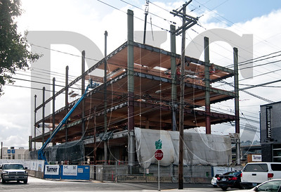 The six-story building will be topped out by late November, with installation of the roof beginning in early December.