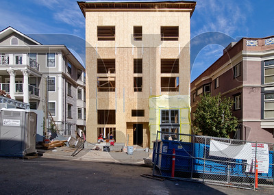 A 30-unit apartment building under construction on Southwest Yamhill Street is one of six Portland projects either in development or under construction by Washington-based Koz Development. (Sam Tenney/DJC)
