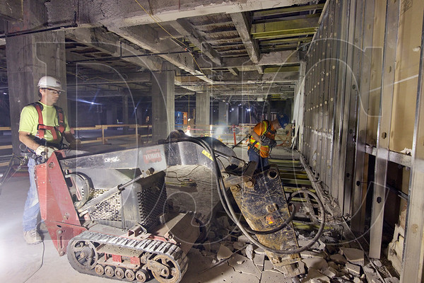 Doyle Crisman, left, and Daniel Long, both employees of Laneco, demolish concrete to create an opening for new HVAC systems on a basement floor at the Meier & Frank Building. (Sam Tenney/DJC)