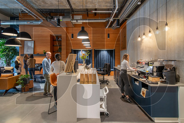 Vacasa's ground-floor lobby reception space contains a coffee counter staffed by a barista.