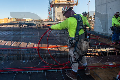 Francisco Gonzalez, a journeyman ironworker with R2M2 Rebar and Stressing, lays down a coil of post-tensioning cable in preparation for a deck pour.