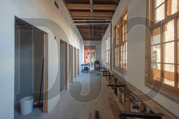 This corridor in The Redd East holds the future event center's restrooms. This view shows the original ceiling timbers salvaged from the 1918 building an re-used. (Josh Kulla/DJC)