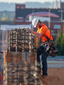 Journeyman carpenter Ryan Eiford, an employee of Marion Construction and a member of Local 1503, builds formwork on the 7 Southeast Stark project. (Josh Kulla/DJC)