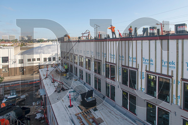 Roofers with McDonald & Wetle Inc. work on The Redd East. (Josh Kulla/DJC)