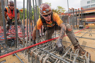 Journeyman ironworker Trevor O'Connor, a member of Local 29 and an employee of R2M2 Rebar & Stressing, builds formwork at the Fourth and Montgomery project in downtown Portland. (Josh Kulla/DJC)