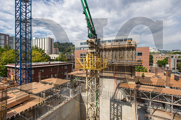 Crews with Andersen Structures, Inc. lay down decking for the third level of the Fourth and Montgomery project on the PSU campus downtown.  (Josh Kulla/DJC)
