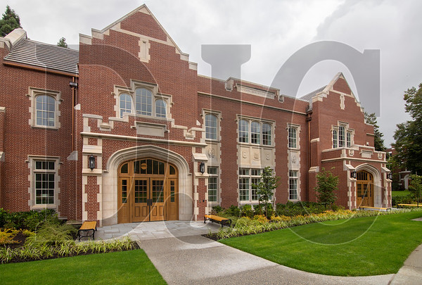 University of Portland's new Dundon-Berchtold Hall is clad in tumbled brick and Indiana limestone. (Sam Tenney/DJC)