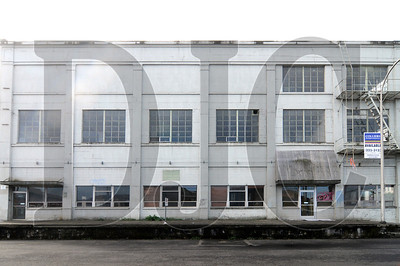 A warehouse building for sale at 320 N.W. Hoyt St features 21,900 square feet over three levels.  Individual floors are also available for lease.