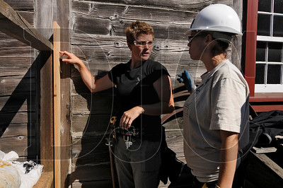 Contractor Holly Huntley, left, shows Samantha Rodriguez, a student in Oregon Tradeswomen's Pathways to Success program, how to build a fence at Fort Vancouver on Tuesday.