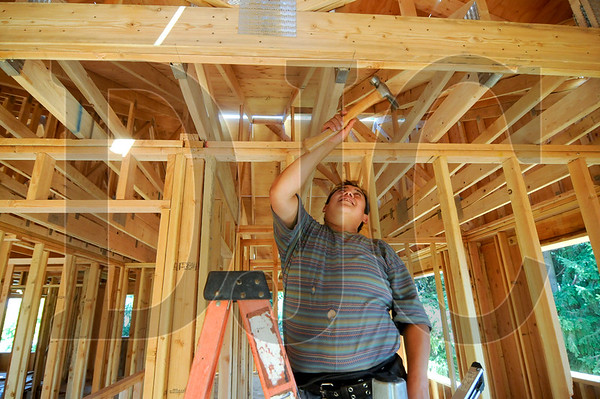 Carpenter Victor Giron frames a roof at the Cully Grove, a Northeast Portland development that is one of 20 green remodels and new homes included in this Saturday's Build It Green! home tour.