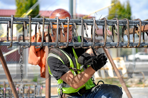 Ironworker John Gentry, a journeyman with Mowry Rebar and member of Local 29, ties rebar for a boundary column at the Prescott Apartments project in North Portland September 10.