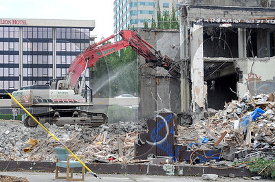 Crews with Staton Companies demolish a two-story building near the Oregon Convention Center to make room for a new mixed-use building with 186 residential units and 3,600 square feet of retail designed by GBD Architects.