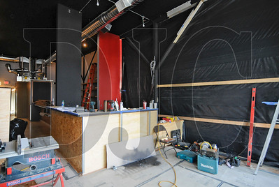 A long-vacant space adjacent to the Sizzle Pie pizza restaurant on East Burnside Street is being renovated into a bar and connected to the restaurant by Robert Coté Construction. Work on the 1,300-square-foot space includes demlolition of a portion of the wall between the spaces, firming up of floor joists, new electrical and HVAC systems, installation of a 100-gallon hot water heater and coolers, dishwashers, and beer taps, and matching finishes to the restaurant side. ADA-compliant bathrooms have been installed, and a corridor was built to connect to Sizzle Pie's back patio space, where a deck will be built. A concrete-top bar was installed, along with bar shelves made from oriented strand board. The bar is expected to open in October.