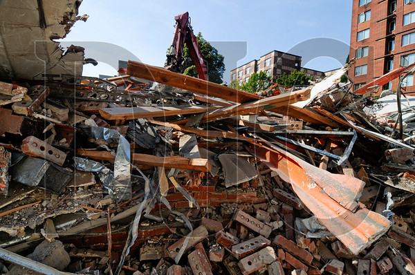 Crews with LOI Environmental & Demolition Services have demolished a two-story office building at Southwest 12th Avenue and Clay Street in downtown Portland and are clearing the site in preparation for a new apartment building. The 8-story project, called the Cameron Apartments, will be built by Bremik Construction for Summit Real Estate Management. The 64,500-square-foot building features 83 units and a ground-floor fitness room, leasing office, and resident amenity spaces. The project's designer is SERA Architects.