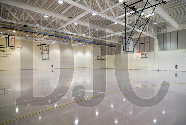 The gymnasium has been outfitted with a cushioned synthetic floor, which consists of an epoxy coating over rubber mat.