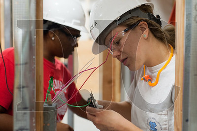 Oregon Tradeswomen pre-apprenticeship student Elizabeth Applegate wires together a light switch during a recent class at the NECA/IBEW Local 48 Electrical Training Center in Northeast Portland. (Josh Kulla/DJC)