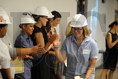 Oregon Tradeswomen pre-apprenticeship graduate Courtney Newberg gets high-fives from fellow graduates Wednesday night at the NECA-IBEW Local 48 Electrical Training Center. Newberg plans to enter an apprenticeship as an ironworker. (Josh Kulla/DJC)