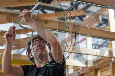 Oregon Tradeswomen pre-apprenticeship student Bethany Whitlock works on wiring a light fixture during a recent class at the NECA/IBEW Local 48 Electrical Training Center. (Josh Kulla/DJC)