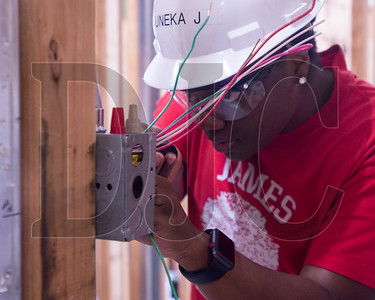 Oregon Tradeswomen pre=apprenticeship student Uneka James installs a light switch during a recent class at the NECA/IBEW Local 48 Electrical Training Center. (Josh Kulla/DJC)