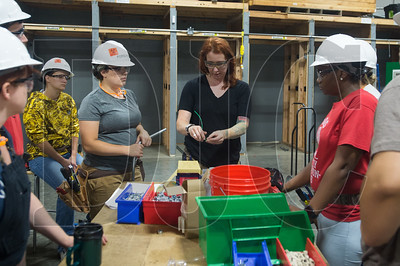 Bridget Quinn; a journeyman electrician and instructor at the NECA-IBEW Electrical Training Center; instructs Oregon Tradeswomen pre-apprenticeship students during a recent class at the Northeast Portland training center. (Josh Kulla/DJC)