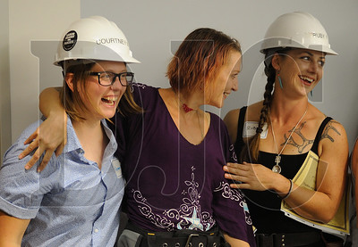 Oregon Tradeswomen Pathways pre-apprenticeship graduates, from left, Courtney Newberg, Sadie Wood and Ruby Fjeld share a laugh at their graduation ceremony Wednesday at the NECA-IBEW Local 48 Electrical Training Center. Newberg and Fjeld plan to enter ironworker apprenticeships, while Wood is applying with Local 16 as a sheet metal worker. (Josh Kulla/DJC)
