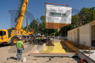A modular unit is flown into place at the LISAH project site in North Portland. (Josh Kulla/DJC)