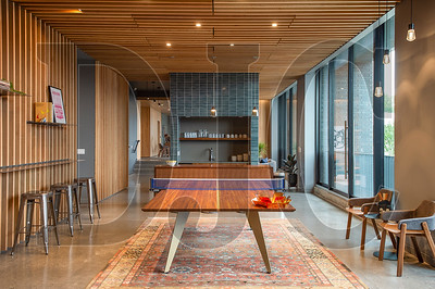 A ground-floor amenity space offers provides gathering and recreation space for tenants. (Josh Kulla/DJC)