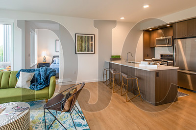Apartment units feature open floor plans and kitchens with gas ranges and quartz countertops. (Josh Kulla/DJC)