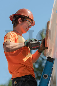 Brody Humphrey, a laborer with Bent Level Construction, helps prepare the rigging for a modular box. (Josh Kulla/DJC)