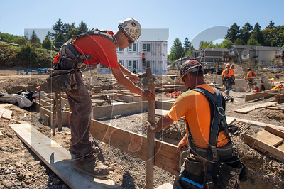Journeyman carpenters Shane Gill, left, and Dan McHarge, both members of Local 1503 and employees of RDF Builders, construct formwork for the foundation of one of the three modular buildings at the LISAH job site. (Josh Kulla/DJC)