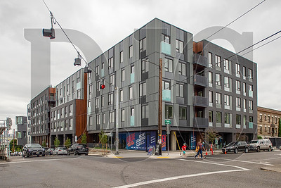 The mixed-use Revere building on North Mississippi Avenue featuers 211 residential units, below-grade parking and ground-floor commercial space.  (Josh Kulla/DJC)