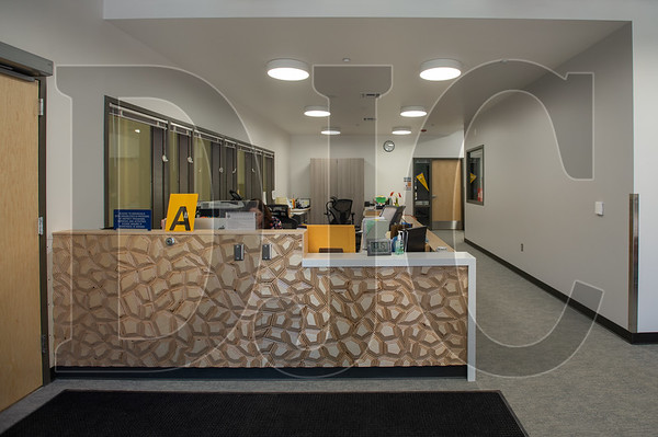 The renovated administrative office features a desk carved in relief from a sheet of plywood. (Josh Kulla/DJC)