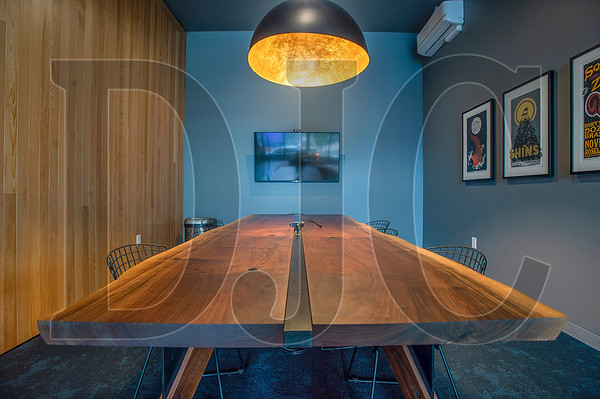 A hardwood table was hand-crafted by a member of the Holst Architecture design team. (Josh Kulla/DJC)