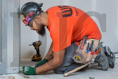 Journeyman carpenter Victor Rodriguez, a member of Local 146 and an employee of Western Partitions Inc., frames an interior wall. (Josh Kulla/DJC)
