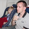 Madison and Daddy watching movie on plane 2 5-21-04
