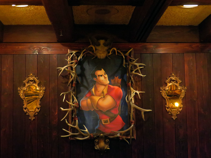 Red Rose Taverne at Disneyland takes over Village Haus restaurant in Fantasyland for temporary marketing promotion for theatrical release of live-action BEAUTY AND THE BEAST. The new location boasts a new menu that includes Poutine, Cauliflower Sandwhich, and the Grey Stuff. It's delicious!